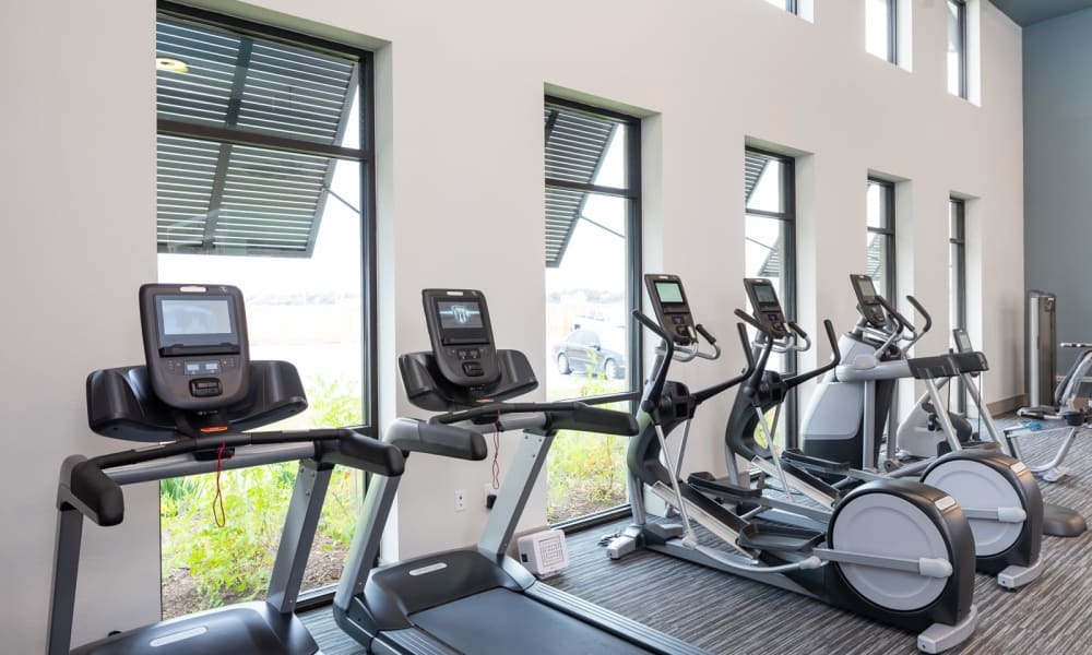 Fitness center with cardio equipment at Bellrock Market Station in Katy, Texas