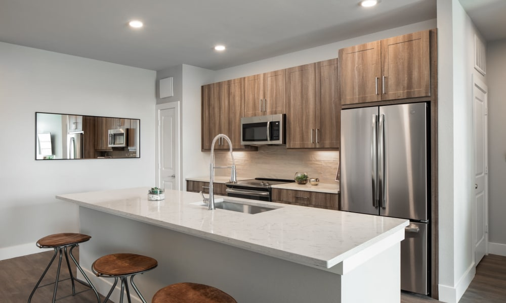 Kitchen with granite counters at Bellrock Market Station in Katy, Texas