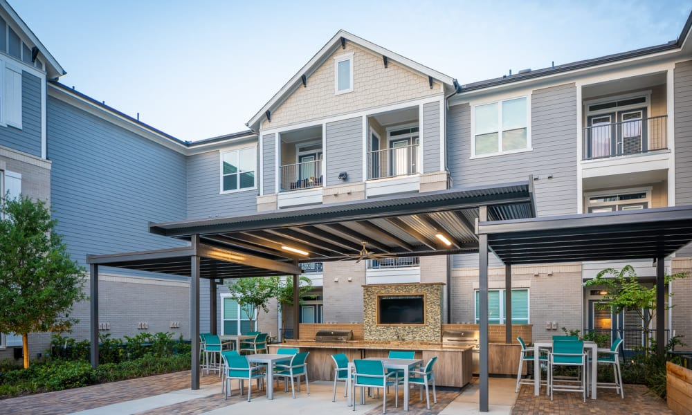 Outdoor poolside social space at Bellrock Market Station in Katy, Texas