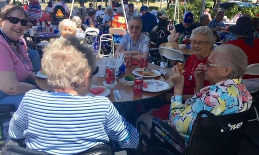 Residents enjoying some lunch outside at Woodside Senior Living in Springfield, Oregon