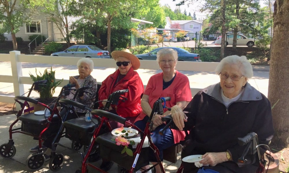 Residents relaxing in the shade at Woodside Senior Living in Springfield, Oregon