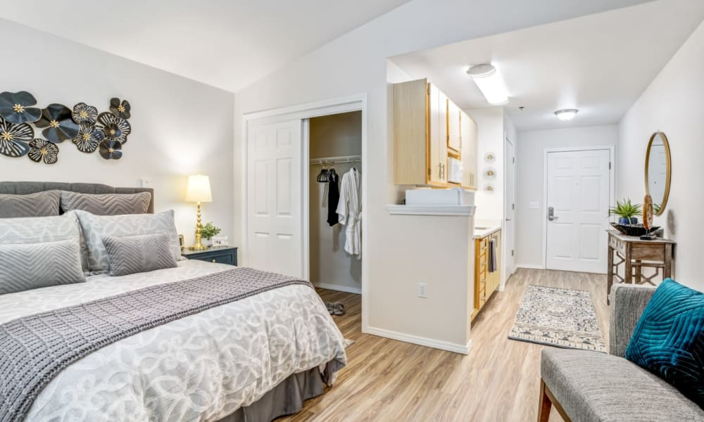 Well decorated bedroom at Woodside Senior Living in Springfield, Oregon