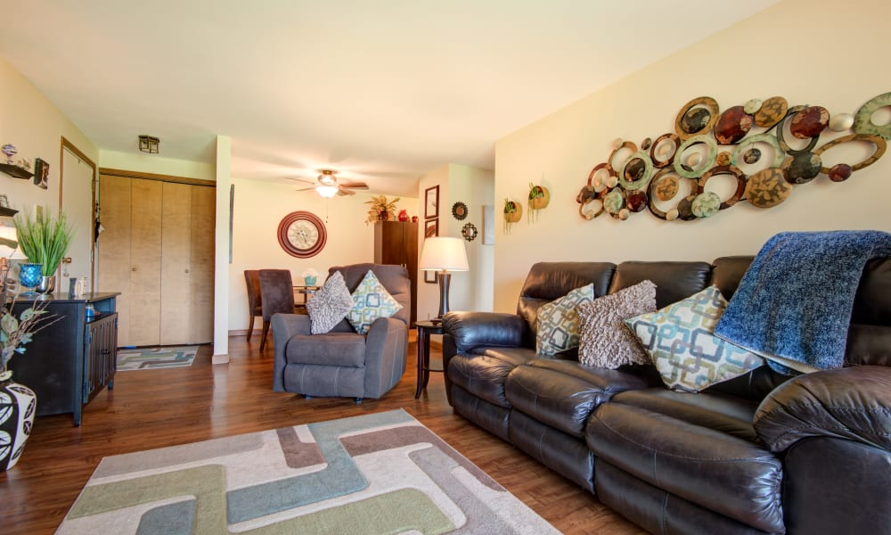 Living room with deck access at Kimbrook Manor Apartments in Baldwinsville, New York