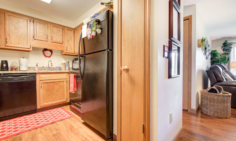 Kitchen with updated appliances at Kimbrook Manor Apartments in Baldwinsville, New York