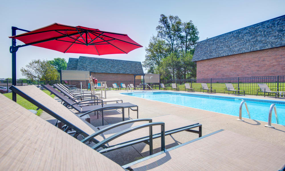 Large tanning deck by the pool at Kimbrook Manor Apartments in Baldwinsville, New York