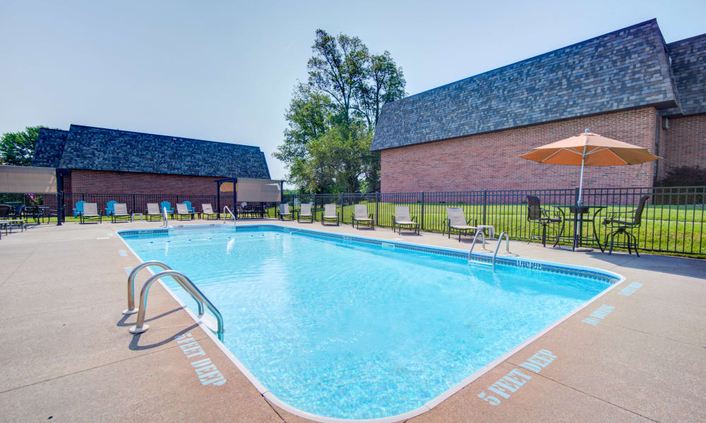 Pool and lounge area at Kimbrook Manor Apartments in Baldwinsville, New York