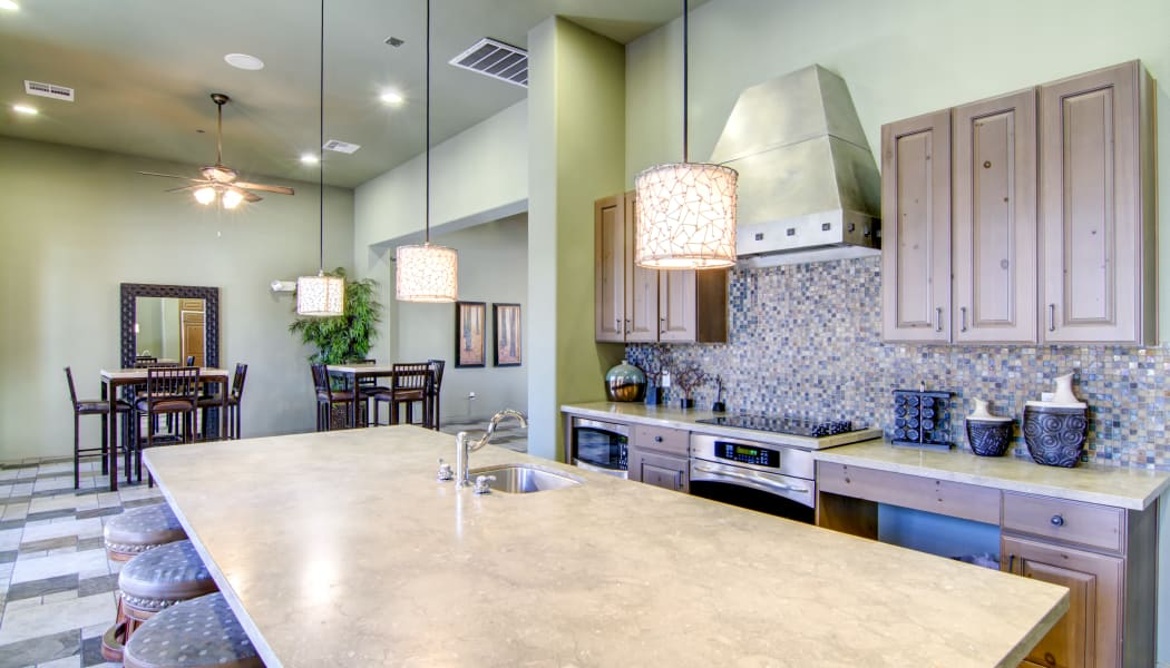 Demonstration kitchen for resident use in the clubhouse at The Residences at Stadium Village in Surprise, Arizona