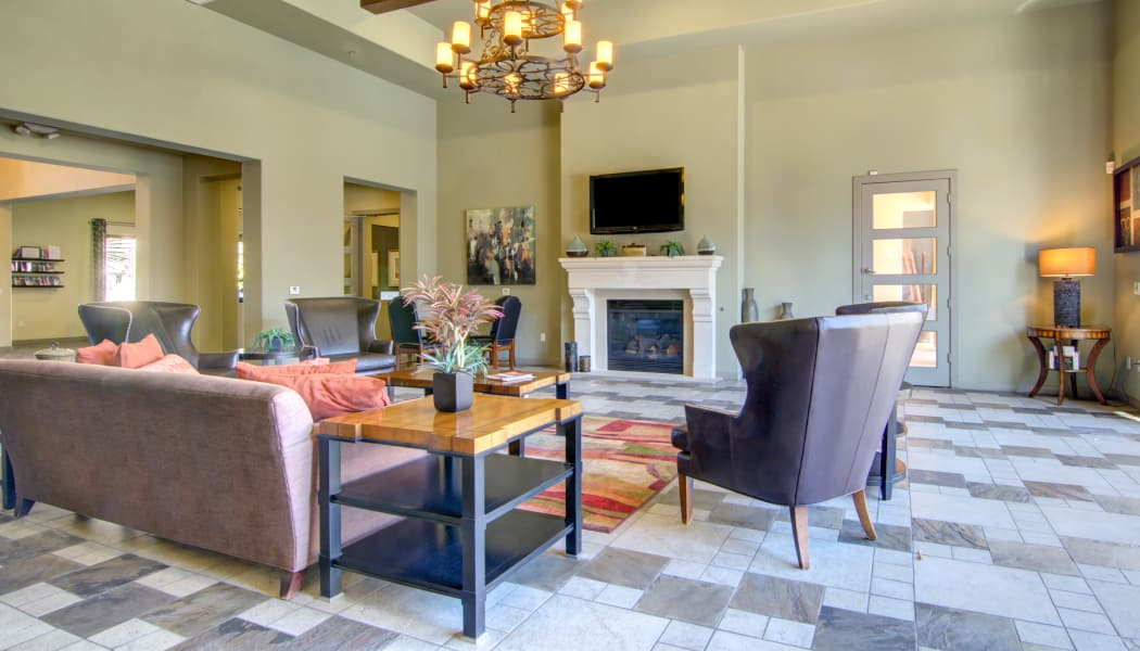 Well-decorated resident clubhouse interior at The Residences at Stadium Village in Surprise, Arizona