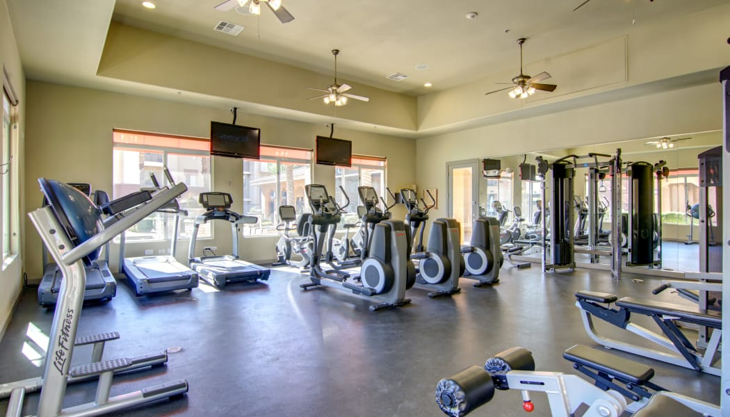 Fully equipped fitness center at The Residences at Stadium Village in Surprise, Arizona