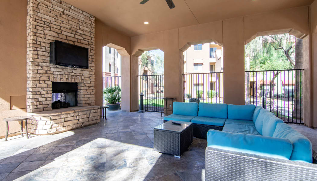 Covered seating near the outside fireplace at The Residences at Stadium Village in Surprise, Arizona