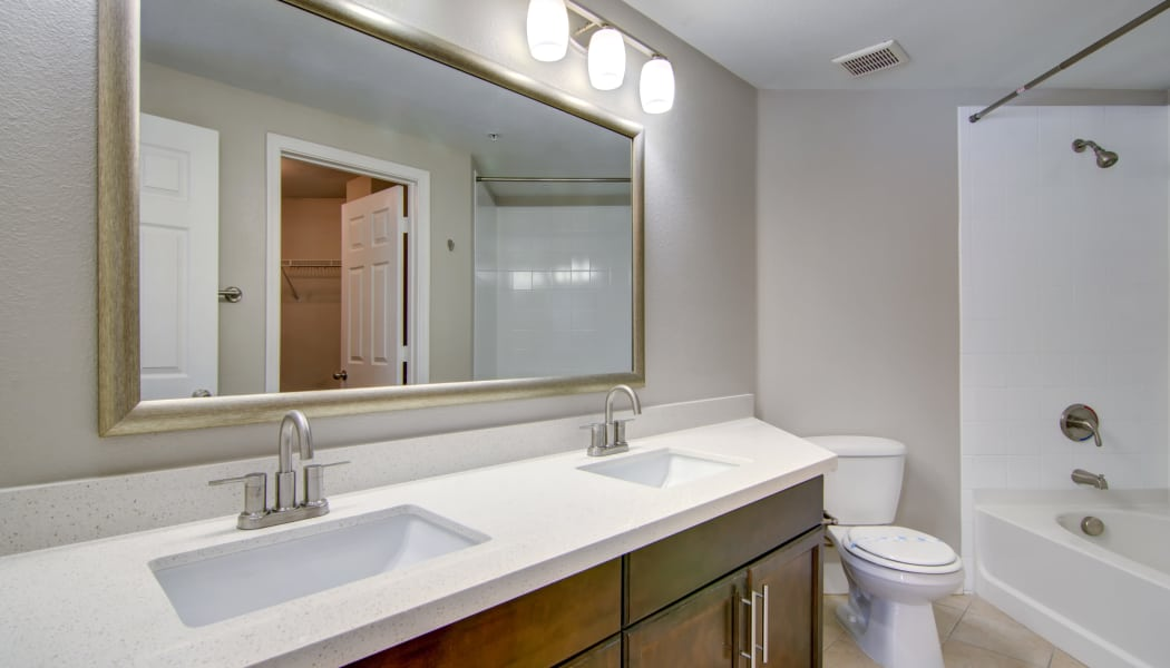 Large vanity mirror in the bathroom of a model home at The Residences at Stadium Village in Surprise, Arizona