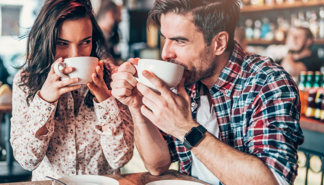Couple enjoying coffee together in Tulsa, Oklahoma near Cedar Ridge