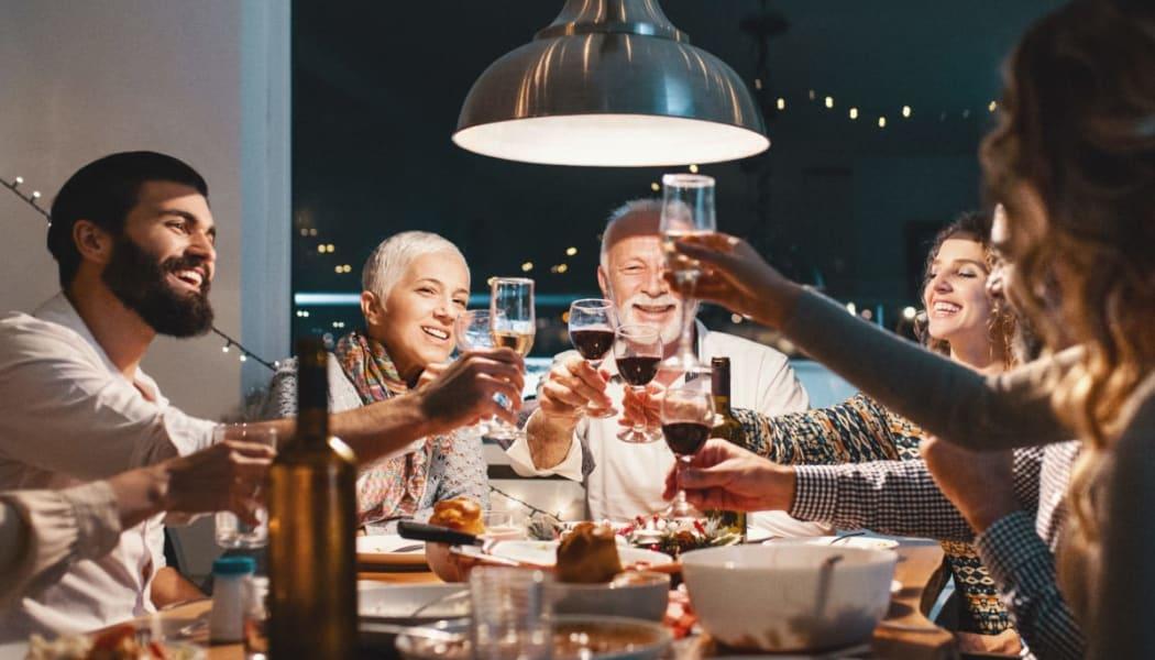 Family enjoying dinner together at The Remington Apartments in Wichita, Kansas