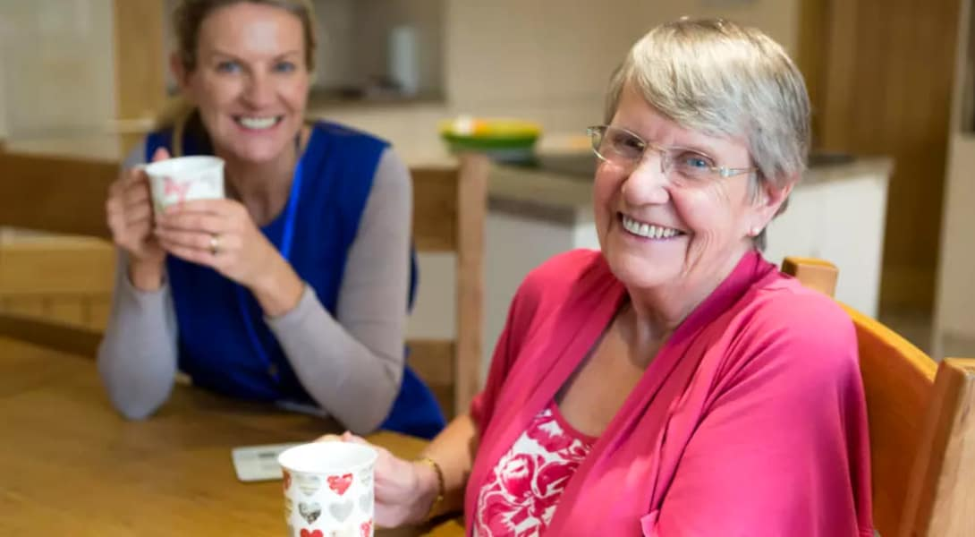 Sumter Senior Living resident has coffee with her caretaker in The Villages