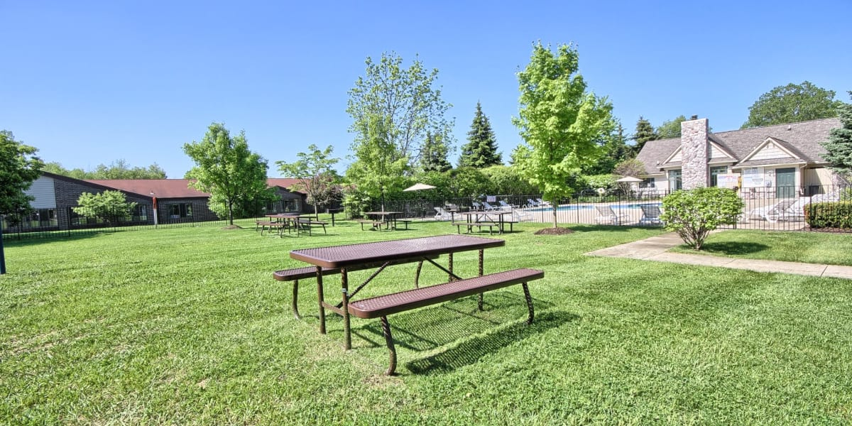 Green space and picnic tables at Legends Fox Creek in Clarkston, Michigan