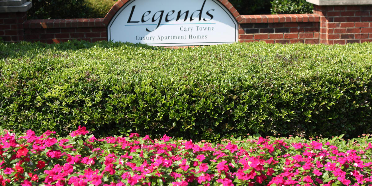 Flowers and sign at entry of Legends Cary Towne in Raleigh, North Carolina