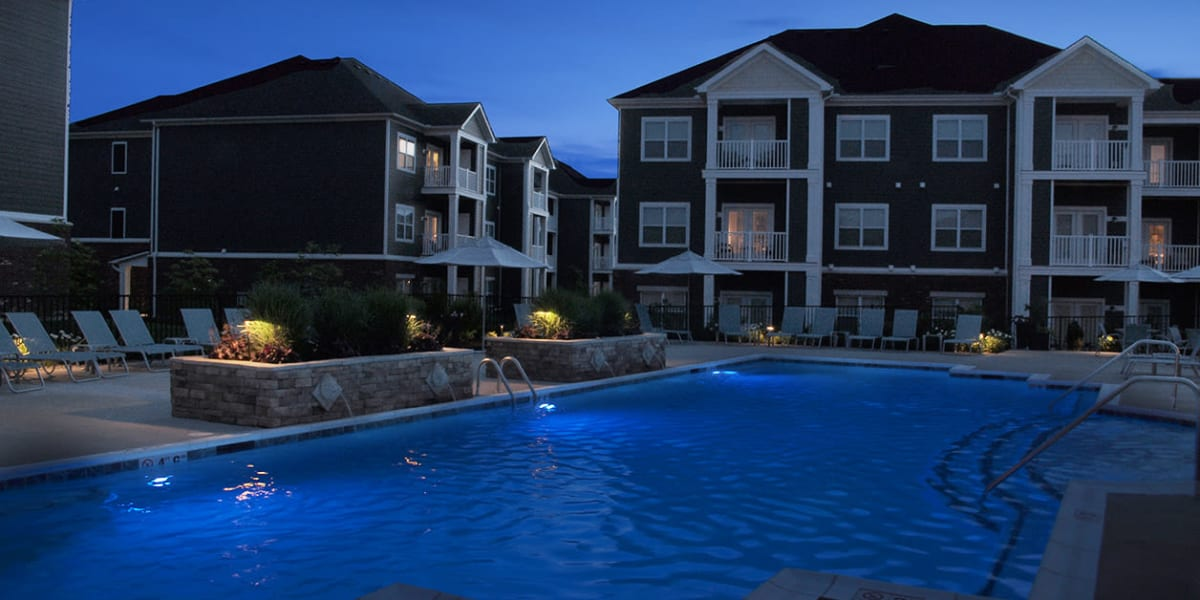 Exterior of buildings and pool at night at Greyson on 27 in Nicholasville, Kentucky