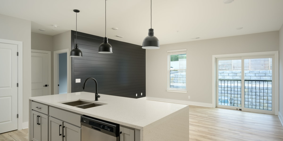 Kitchen overlooking the living room at The Stovall manged by Callio Properties