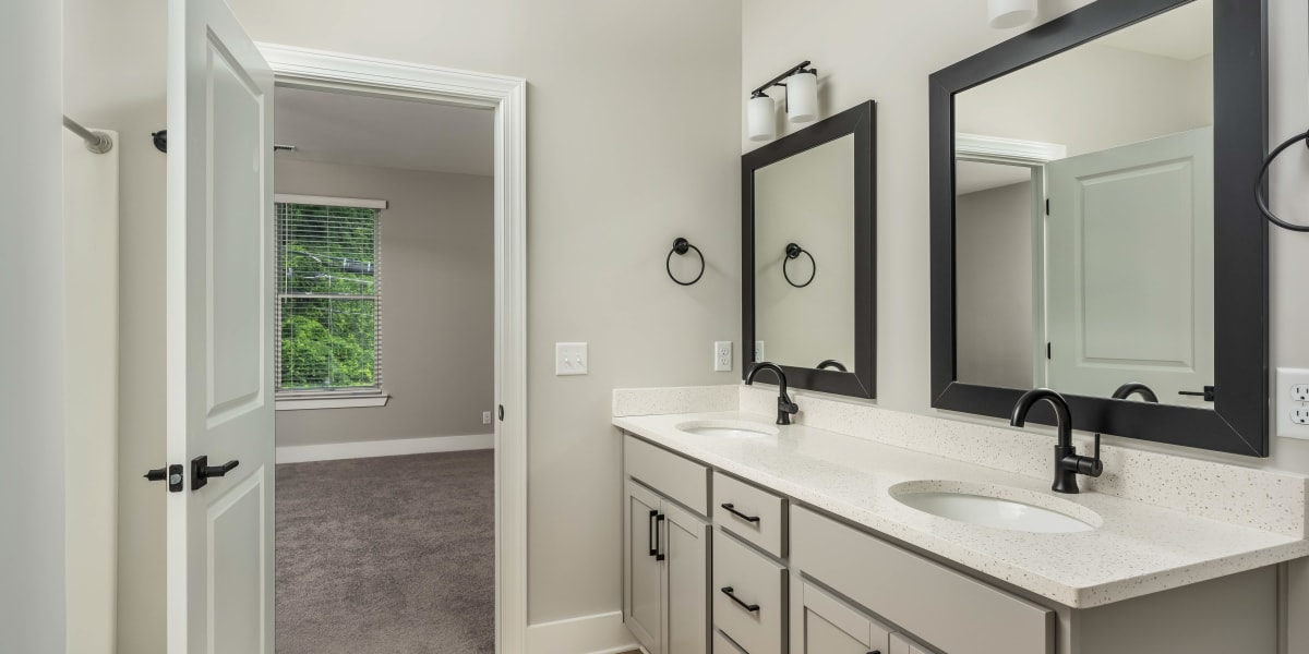 Beautiful dual sink bathroom at The Stovall manged by Callio Properties