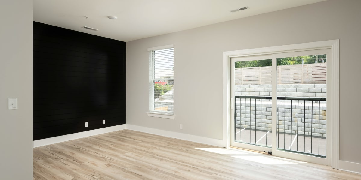 Spacious living room with patio access at The Stovall manged by Callio Properties