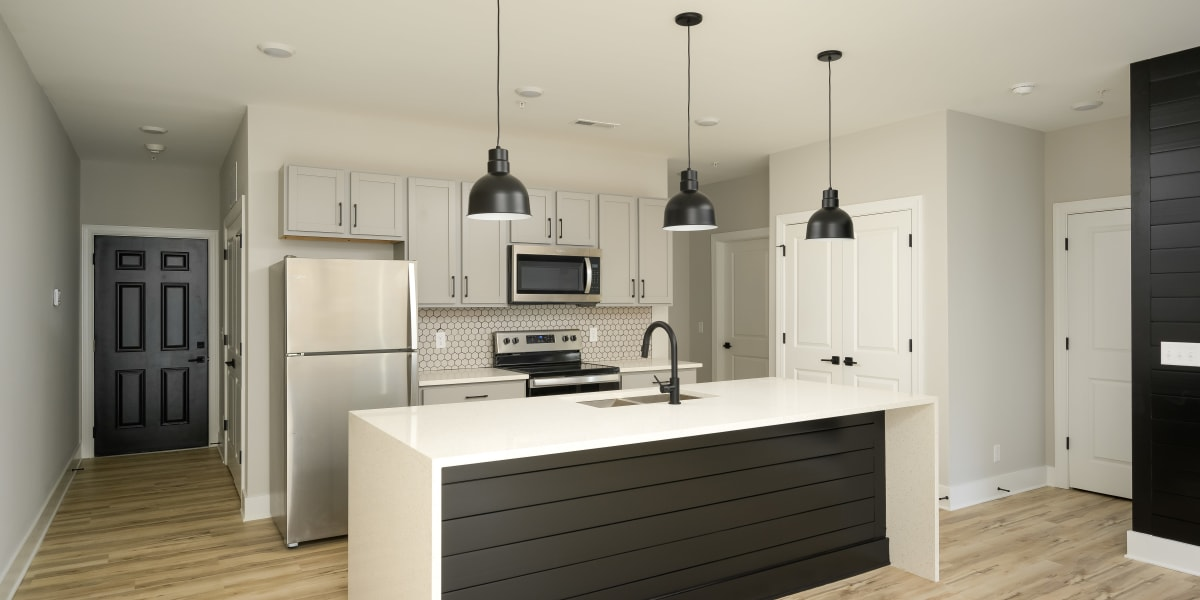 Kitchen with a breakfast counter at The Stovall manged by Callio Properties