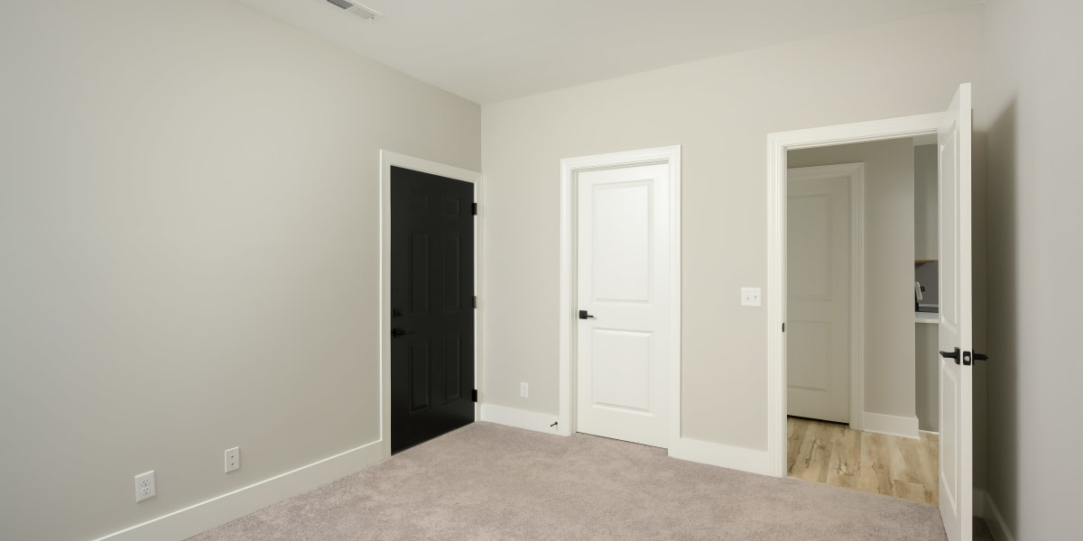Spacious main bedroom with a closet at The Stovall manged by Callio Properties