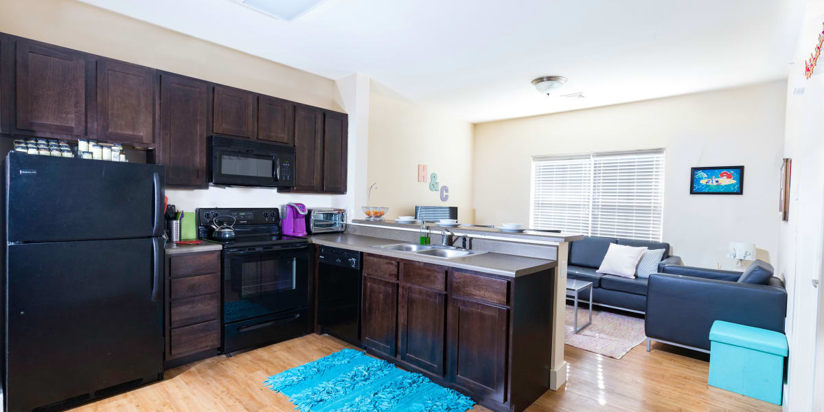 A kitchen with plenty of cabinet space at Beacon Springfield in Springfield, Missouri
