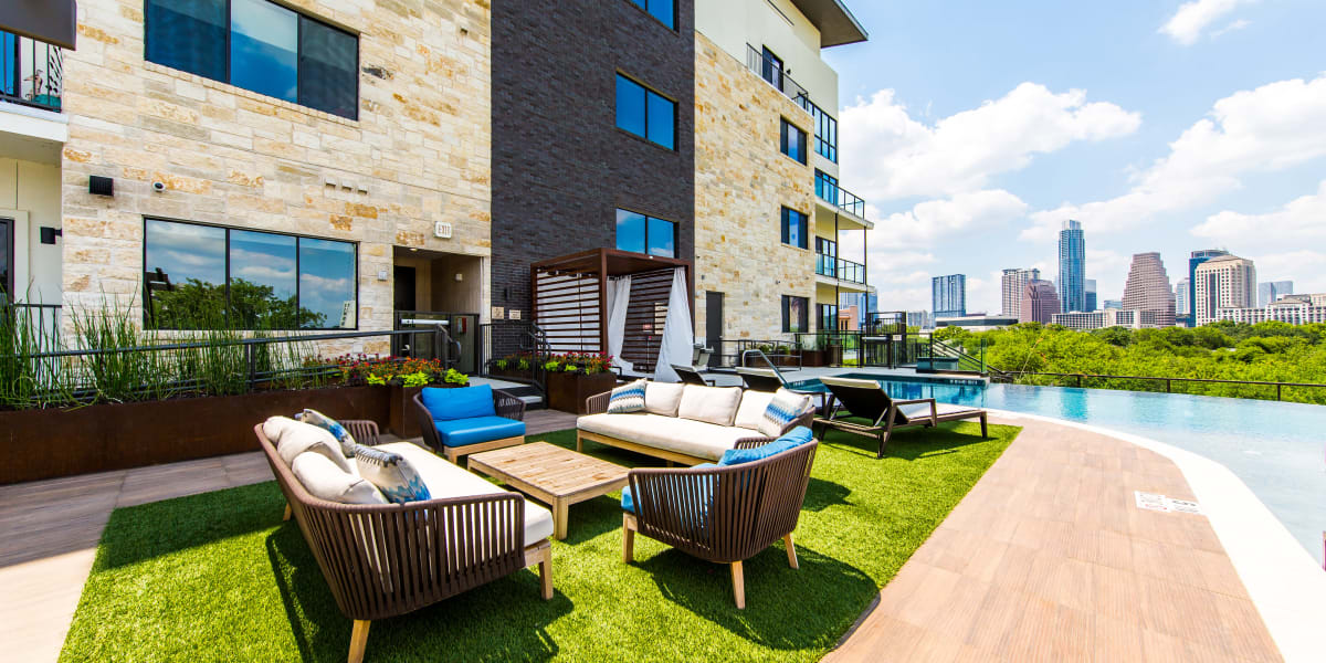 Outdoor poolside seating at Water Marq in Austin, Texas