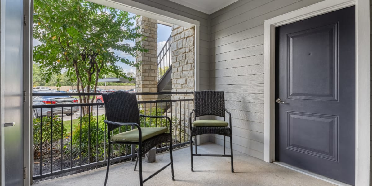 Patio with chairs at Marquis at Sugar Land in Sugar Land, Texas