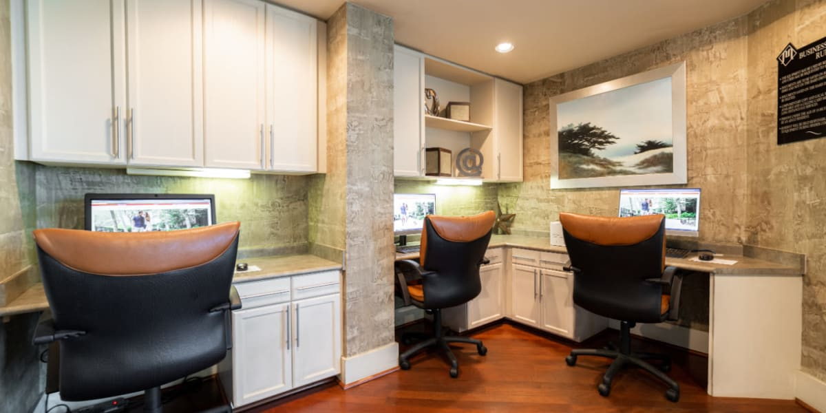 Executive business center with workstations at Marquis at Texas Street in Dallas, Texas