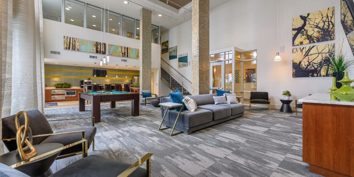 Community clubhouse with pool table and sitting areas at Sabina in Austin, Texas
