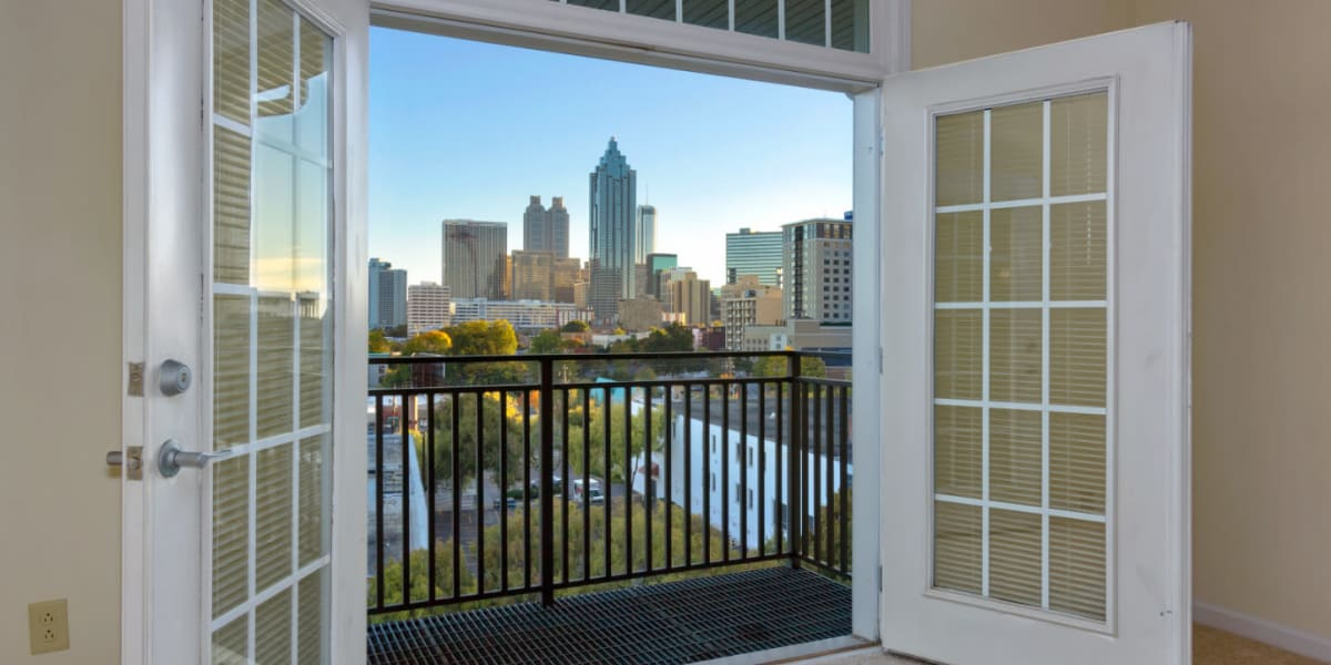 Double door opening to steel balcony with view of downtown at Marq on Ponce in Atlanta, Georgia