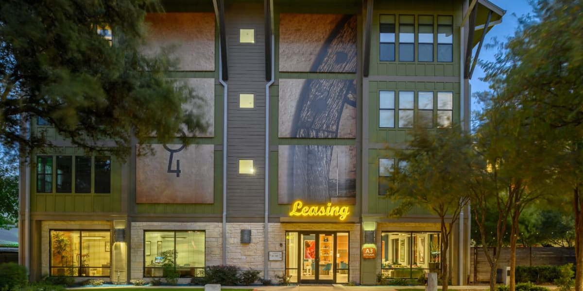 Leasing office entrance at sunset of The 704 in Austin, Texas