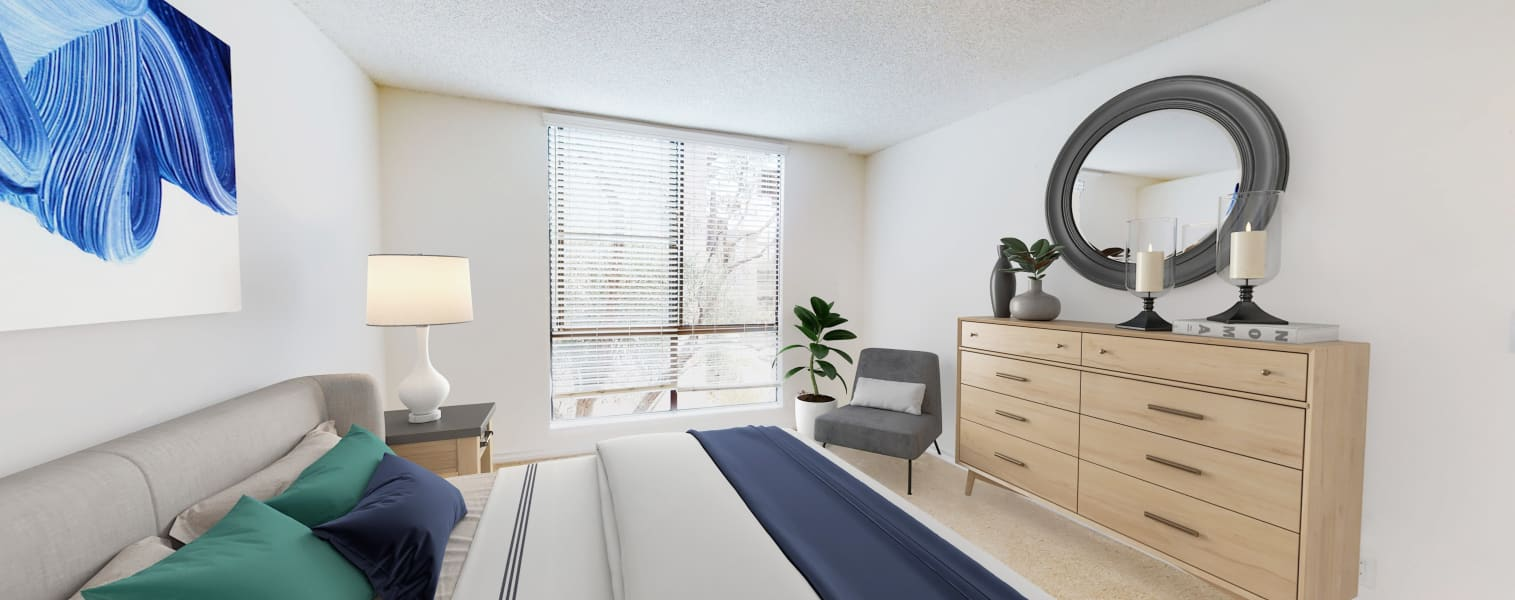Bay windows and plush carpeting in a model home's primary bedroom at Mariners Village in Marina del Rey, California