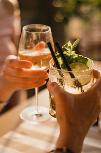 Friends drinking wine together in Pompano Beach, Florida near Linden Pointe