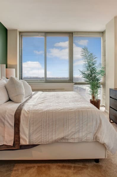 Furnished bedroom at Skyline New Rochelle in New Rochelle, New York