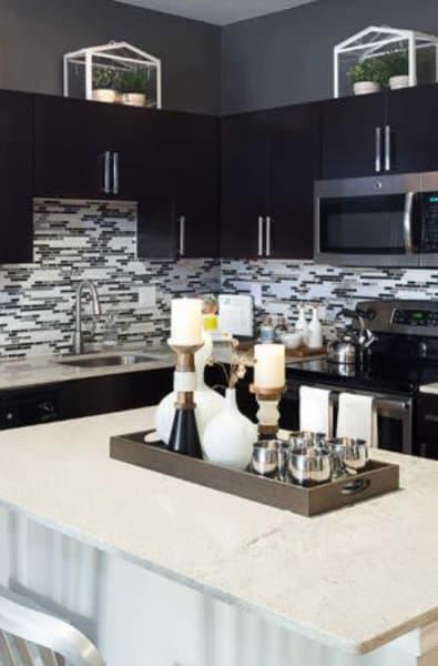 Kitchen island at Alesio Urban Center in Irving, Texas