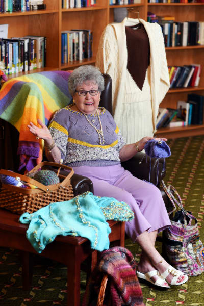 Happy senior resident knitting at Mattison Crossing at Manalapan Avenue in Freehold, New Jersey