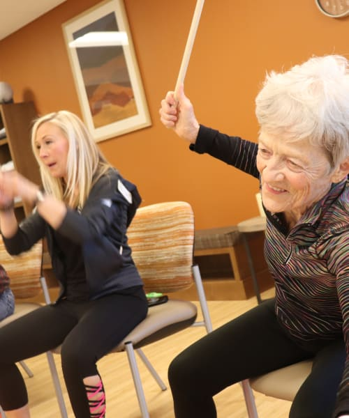 Residents engaged in drumming exercise class at The Springs at Bozeman in Bozeman, Montana