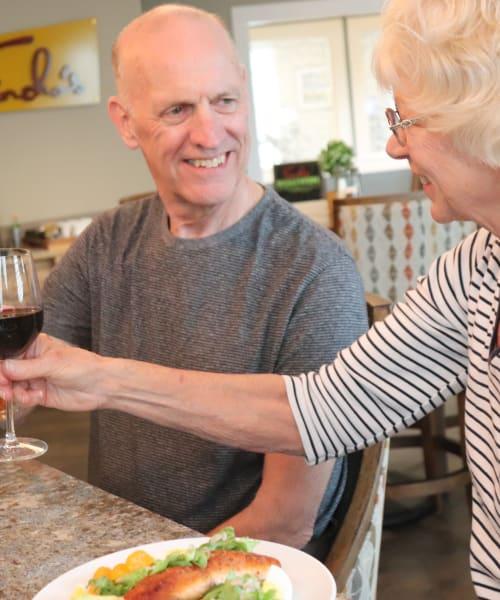 Resident couple enjoying drinks at The Springs at Sherwood in Sherwood, Oregon