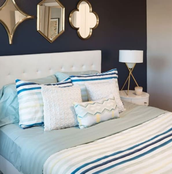 Bright, well decorated bedroom at Alesio Urban Center in Irving, Texas