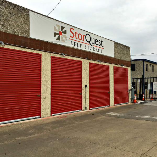 Outdoor storage units with bright doors at StorQuest Self Storage in Dallas, Texas