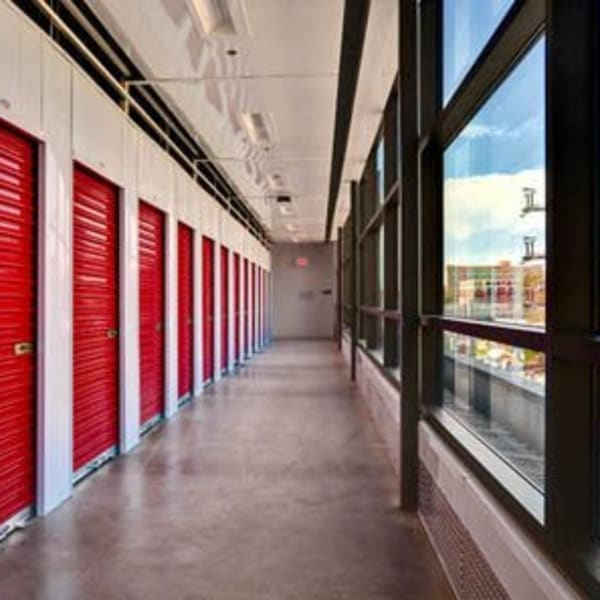 Red doors on indoor units at StorQuest Self Storage in Los Angeles, California