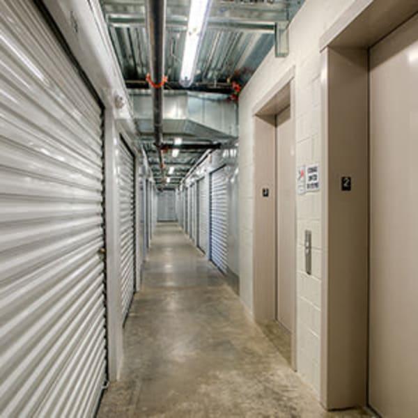 Indoor storage units with white doors at StorQuest Self Storage in Littleton, Colorado