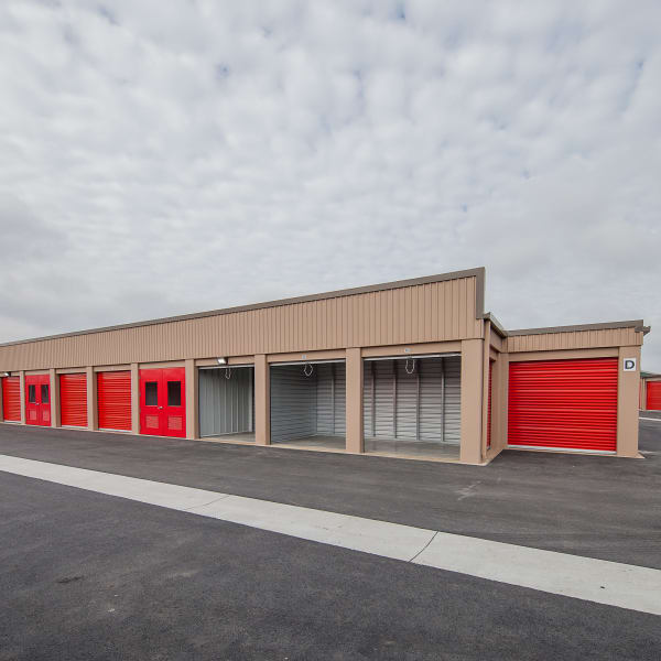 Outdoor storage units with bright doors at StorQuest Self Storage in Brentwood, California