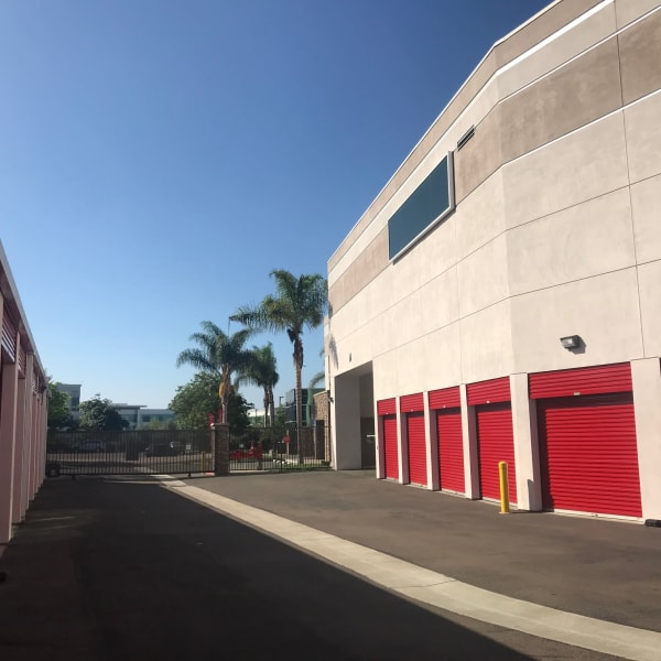 Outdoor storage units with bright doors at StorQuest Self Storage in Carlsbad, California