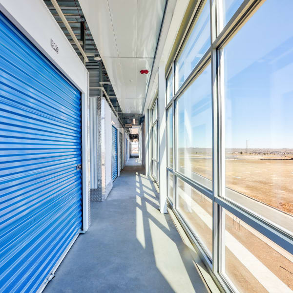 Indoor units with blue doors at StorQuest Self Storage in Arvada, Colorado