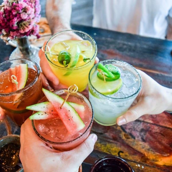 Friends having fruity cocktails near TEMPŌ in Cambridge, Massachusetts