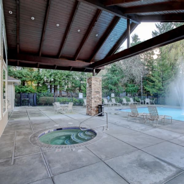 Covered hot tub for colder weather enjoyment at The Dakota Apartments in Lacey, Washington
