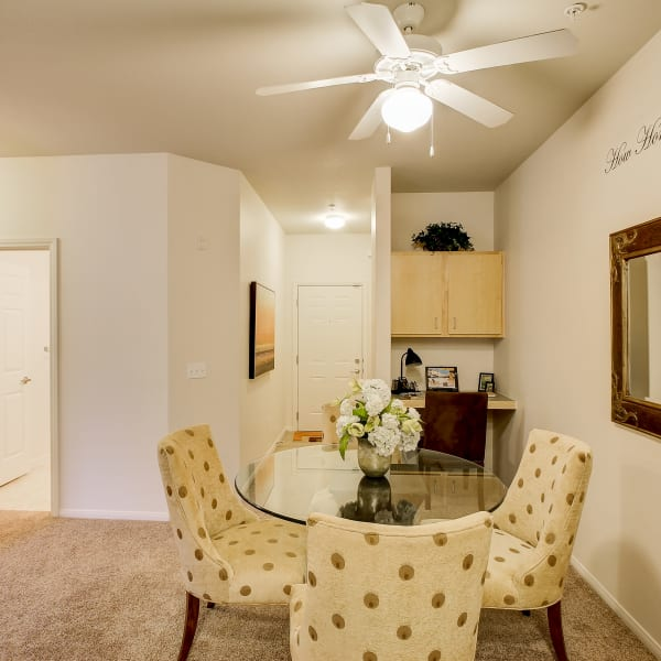 Spacious dining room with a ceiling fan at The Dakota Apartments in Lacey, Washington